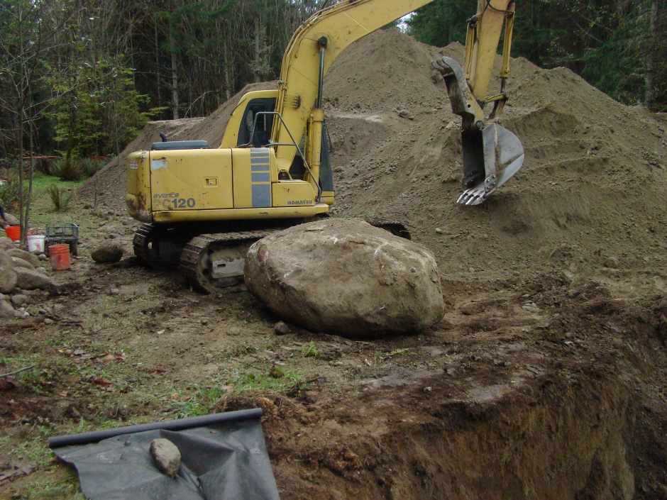 Excavator moving rock
