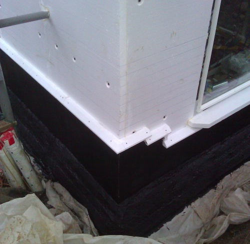 Black waterproofing over two sheets of EPS