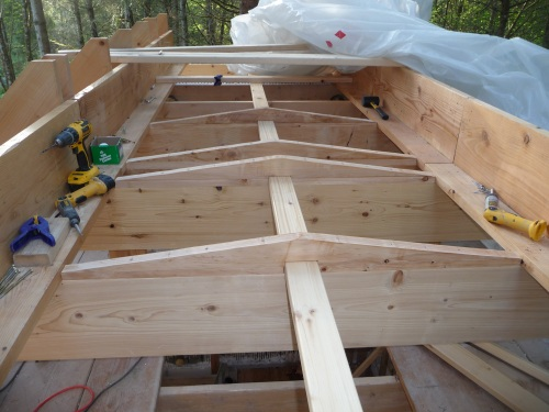 Flat Roof Sloping Pieces Being Added
